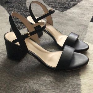 Cole Haan black sandals.